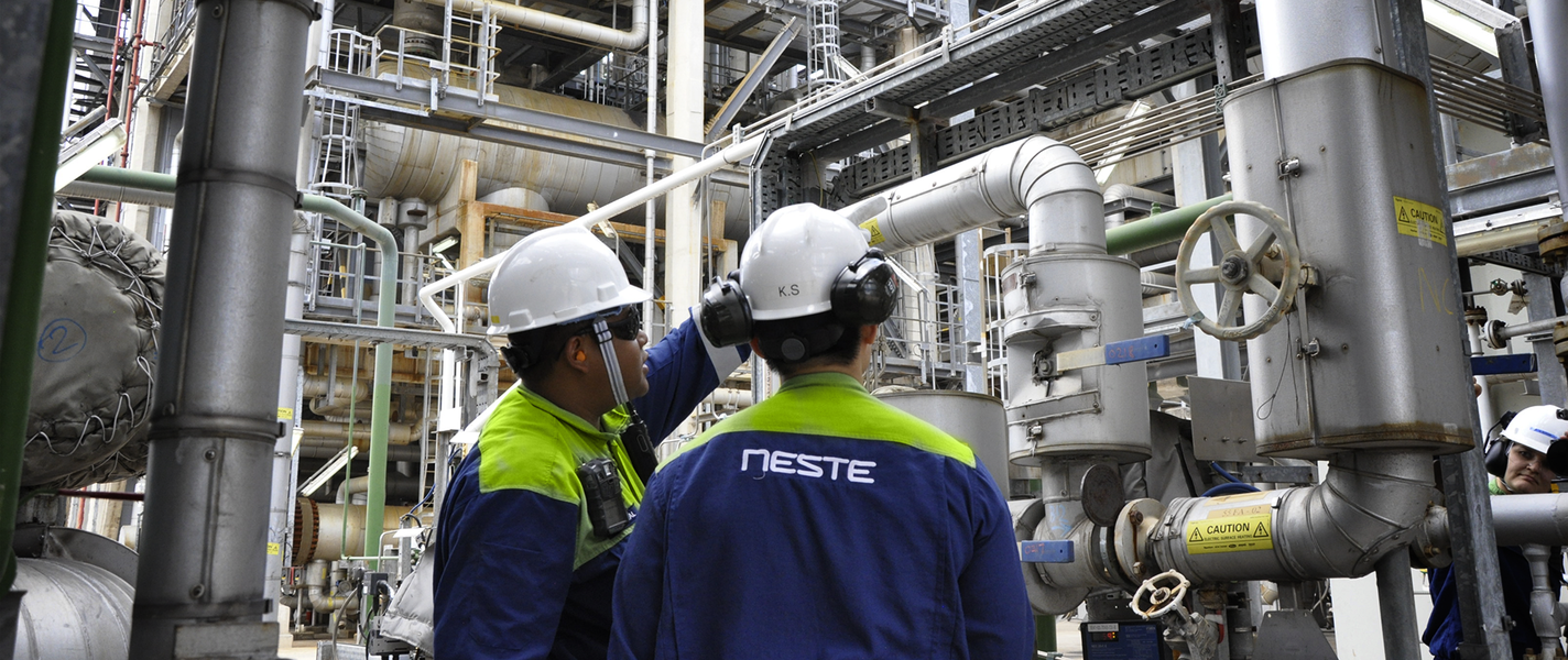 To Neste Employees Observing Pipe