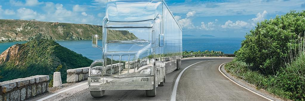 Transparent bus driving by a city